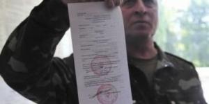 В Одессе сотрудники военкомата вручили повестки сокращенным из ОГА чиновникам