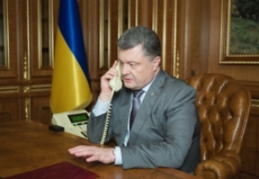 Порошенко, Меркель, Олланд и Путин обсудили ситуацию на Донбассе и договорились как можно быстрее собрать Контактную группу