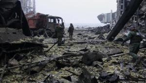 В донецком аэропорту из-под завалов достали семерых украинских военных