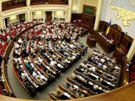 Депутаты приняли закон о люстрации. В это время активисты жгли автомобильные покрышки