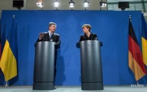 Порошенко поблагодарил Меркель за давление на Россию