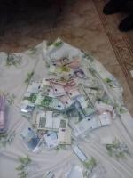 В квартире пойманного на взятке экс-ректора НАУ нашли 4,5 млн. грн. и 10 банковских карточек